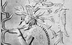 멕시코 마야 유적에 새겨진, 담배를 피우는 신관의 모습