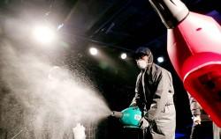 종로구 대학로의 한 소극장에서 서울시 관계자들이 방역 소독을 하고 있다