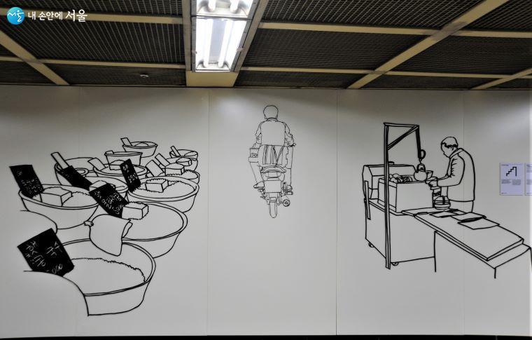 'STAIR 미술관' 지하 1·2층 연결 통로의 황혜선 작 「시장 풍경」 ⓒ조수봉